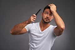 Young man with comb Royalty Free Stock Photo