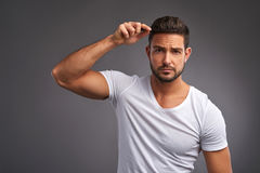 Young man with comb Royalty Free Stock Images