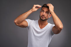 Young man with comb Royalty Free Stock Photography