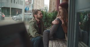 Young man comforting sad woman. Caring friend consoling upset girl. Compassion, empathy and support in relationships concept stock video footage