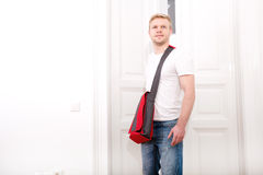 Young man coming home Stock Images