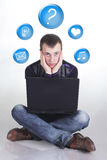 Young man with computer Stock Image