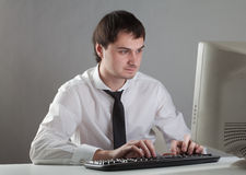 Young man at the computer Stock Photography