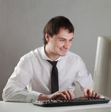 Young man at the computer Stock Images