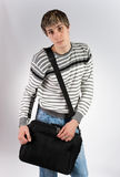 A young man with a computer bag Stock Image