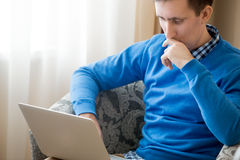 Young man concentrated on work Royalty Free Stock Images