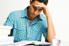 Young man concentrating Royalty Free Stock Image