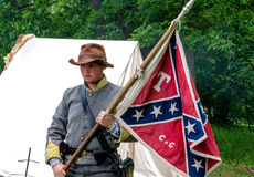 Young man with confederate flag. A young man poses with a southern confederate flag at a civil war reenactment in Indiana Stock Images