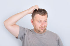 Young man with confused expression. On face Royalty Free Stock Photo