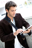 Young man connected on tablet Royalty Free Stock Photography