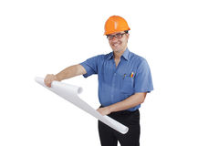 Young man in a construction helmet with the project in the hands Stock Photo