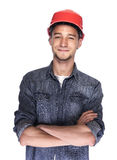 Young man in a construction helmet. Royalty Free Stock Photo