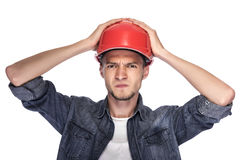 Young man in a construction helmet. Royalty Free Stock Photos