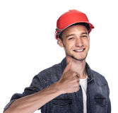 Young man in a construction helmet. Royalty Free Stock Photography