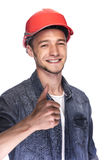 Young man in a construction helmet. Stock Photo