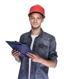 Young man in a construction helmet. Royalty Free Stock Images