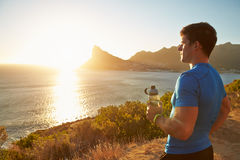 Young man contemplating after jogging Royalty Free Stock Image