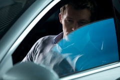 Young man contemplating in new car Royalty Free Stock Photography