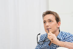 Young Man Contemplating Royalty Free Stock Images