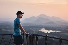 Man contemplation at the sunset. Young man contemplation at the sunset. View from Sigiriya rock in Sri Lanka royalty free stock photos