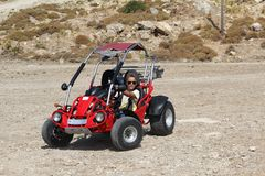 A young man controls a buggy royalty free stock photo