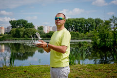 The young man controls the drone by remote. Young man controls the drone by remote royalty free stock photos