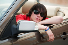 Young man in a convertible. Royalty Free Stock Photos