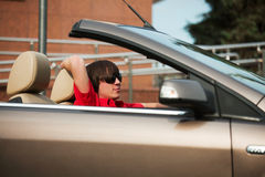 Young man in a convertible. Royalty Free Stock Image