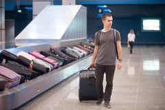 Young man at conveyor belt Royalty Free Stock Photos