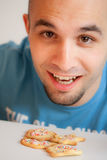Young man with cookies Stock Photo