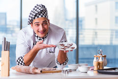 The young man cooking cookies in kitchen Royalty Free Stock Images