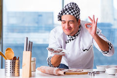 The young man cooking cookies in kitchen Royalty Free Stock Photos