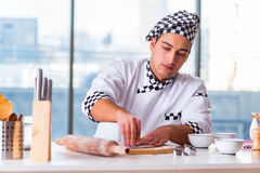 The young man cooking cookies in kitchen Stock Photo