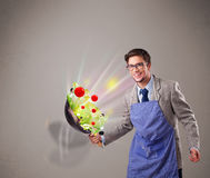 Young man cooking fresh vegetables Royalty Free Stock Photography