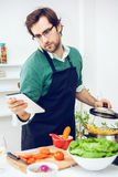 Young Man cooking Stock Image