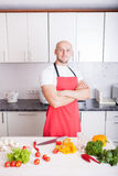 Young Man Cooking Stock Photography