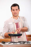 Young man cooking Royalty Free Stock Photo