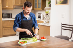 Young man cooking at home Royalty Free Stock Image