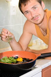 Young man cooking sea food. Stock Photography
