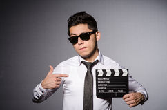 Young man in cool sunglasses holding chalkboard Stock Photography