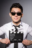 Young man in cool sunglasses holding chalkboard Royalty Free Stock Photos