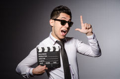 Young man in cool sunglasses holding chalkboard Royalty Free Stock Photography