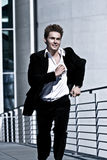 Young Man In Corporate Attire Running. Photo Of A Young Man In Corporate Attire Running Royalty Free Stock Images