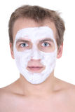 Young man with cosmetic mask on his face Royalty Free Stock Images