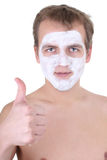 Young man with cosmetic mask on his face thumbs up Stock Images
