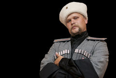 Young man in a cossack clothes. On a black background Royalty Free Stock Image