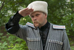 Young man in a cossack clothes. In a forest Stock Photo