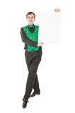 Young man in costume for irish dance with empty banner. Isolated Royalty Free Stock Photography