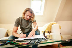 Young Man On Couch, Drawing In Coloring Book Stock Images