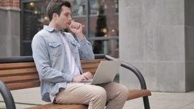 Young Man Coughing while Working on Laptop Outdoor. 4k high quality, 4k high quality stock footage